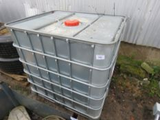 IBC CONTAINER WITH CONTENTS OF HYDRAULIC OIL. APPROX HALF FULL.