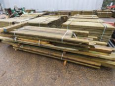 LARGE PACK OF ASSORTED TIMBER POSTS AND FENCING SUPPLIES.