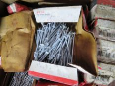 BOX CONTAINING A LARGE AMOUNT OF HILTI NAIL FIXINGS.