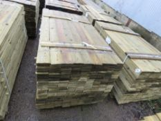 LARGE PACK OF FEATHER EDGE TIMBER FENCE CLADDING. 1.65M LENGTH X 10.5CM WIDTH APPROX.
