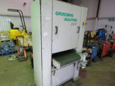 GRINDING MASTER 2000 BELT SANDING UNIT WITH MOVING BELT BASE. YEAR 1997. DIRECT FROM FABRICATION CO