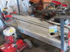 RUBI DX250-1400 TILE CUTTING SAWBENCH, YEAR 2013, 110VOLT POWERED. WITH A SPRE NEW BLADE. DIRECT FRO