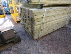 LARGE PACK OF TREATED FEATHER EDGE FENCE CLADDING TIMBERS. 1.5M X 10CM WIDTH APPROX.