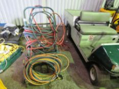 GAS CUTTING HOSES PLUS A TROLLEY AND GUAGES ETC.