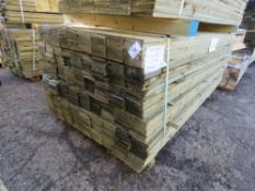 LARGE PACK OF TREATED FEATHER EDGE FENCE CLADDING TIMBERS. 1.8M X 10CM WIDTH APPROX.