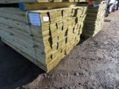PACK OF TREATED FEATHER EDGE FENCE CLADDING BOARDS. 1.5M X 10CM APPROX.