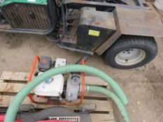 PETROL ENGINED WATER PUMP WITH HOSE.
