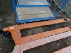 LONG TINED PALLET TRUCK. WHEN TESTED WAS SEEN TO LIFT AND LOWER.