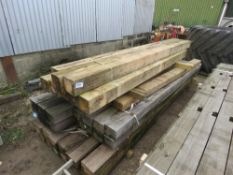 STACK OF TIMBER POSTS 2.4-3.3METRES APPROX.