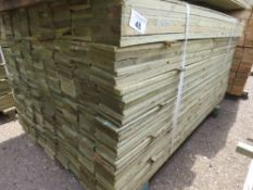 LARGE PACK OF FEATHER EDGE CLADDING TIMBER 1.5M X 10CM APPROX, PRESSURE TREATED.