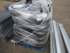 STACK OF ASSORTED RIDE ON TRACTOR/MOWER WHEELS AND TYRES.