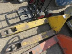 NARROW PALLET TRUCK, SOURCED FROM COMPANY LIQUIDATION. WHEN TESTED WAS SEEN TO LIFT AND LOWER.