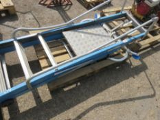 STEP LADDER PLUS LADDER STAY AND ROOF LADDER WHEELS.