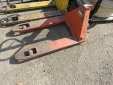 WIDE PALLET TRUCK, SOURCED FROM COMPANY LIQUIDATION. WHEN TESTED WAS SEEN TO LIFT AND LOWER.