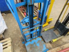 BLUE CHAIN LIFT HAND OPERATED MATERIAL LIFT AND SHIFT UNIT. WHEN TESTED WAS SEEN TO LIFT AND LOWER.