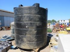 LARGE CAPACITY PLASTIC WATER TANK WITH BOTTOM OUTLET PIPE.