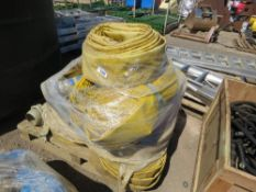 PALLET OF LARGE SIZED LAY FLAT WATER PUMP HOSES WITH SOME CONNECTIONS AND STRAINERS.