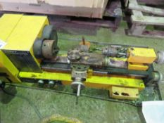 SMALL SIZED MODEL MAKER'S LATHE WITH SMALL AMOUNT OF TOOLING AS SHOWN.