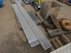 PAIR OF LOADING RAMPS, 9FT LENGTH APPROX, DAMAGE ON ONE END.