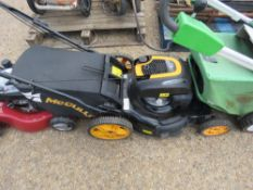 McCULLOCH WIDE CUT DRIVEN MOWER WITH COLLECTOR BAG. WHEN TESTED WAS SEEN TO DRIVE AND BLADE TURNED.