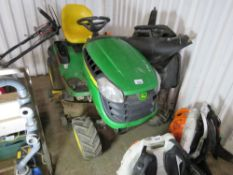 JOHN DEERE X165 PETROL ENGINED RIDE ON MOWER. WHNE TESTED WAS SEEN TO RUN, DRIVE, AND BLADES TURNED.
