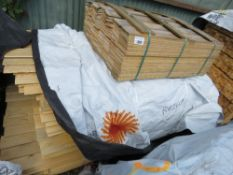 STACK OF UNTREATED HIT AND MISS AND SHIPLAP FENCE CLADDING TIMBERS.