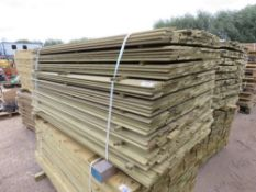 LARGE PACK OF PRESSURE TREATED SHIPLAP FENCING TIMBER. 1.72M LENGTH X 10CM WIDTH APPROX.