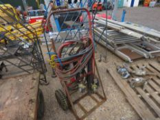 GAS CUTTING HOSES AND EQUIPMENT ON TROLLEY.