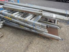 STACK OF ALUMINIUM SCAFFOLD TOWER FRAMES, BOARDS, LEGS AND CROSS MEMBERS. NO VAT ON HAMMER PRICE.