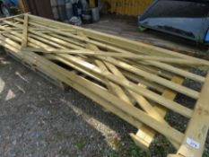 2 X WOODEN FIELD GATES @ 4.2M AND 3.6M WIDTH (SOME DAMAGE ON LOWER BAR OF 3.6M GATE).