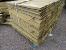 LARGE PACK OF PRESSURE TREATED FEATHER EDGE FENCING TIMBER. 1.04 LENGTH X 10CM WIDTH APPROX.