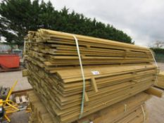 LARGE PACK OF PRESSURE TREATED SHIPLAP FENCING TIMBER. 1.73M LENGTH X 9.5CM WIDTH APPROX.