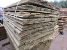 LARGE PACK OF PRESSURE TREATED SHIPLAP FENCING TIMBER. 1.73M LENGTH X 10CM WIDTH APPROX.