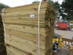 LARGE PACK OF PRESSURE TREATED FEATHER EDGE FENCING TIMBER. 1.05 LENGTH X 10CM WIDTH APPROX.