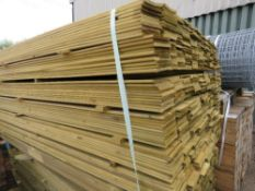 LARGE PACK OF TREATED HIT AND MISS FENCE CLADDING TIMBER BOARDS, 1.75 M LENGTH X 10CM WIDTH APPROX.