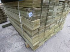 LARGE PACK OF PRESSURE TREATED FEATHER EDGE FENCING TIMBER. 1.66M LENGTH X 10CM WIDTH APPROX.