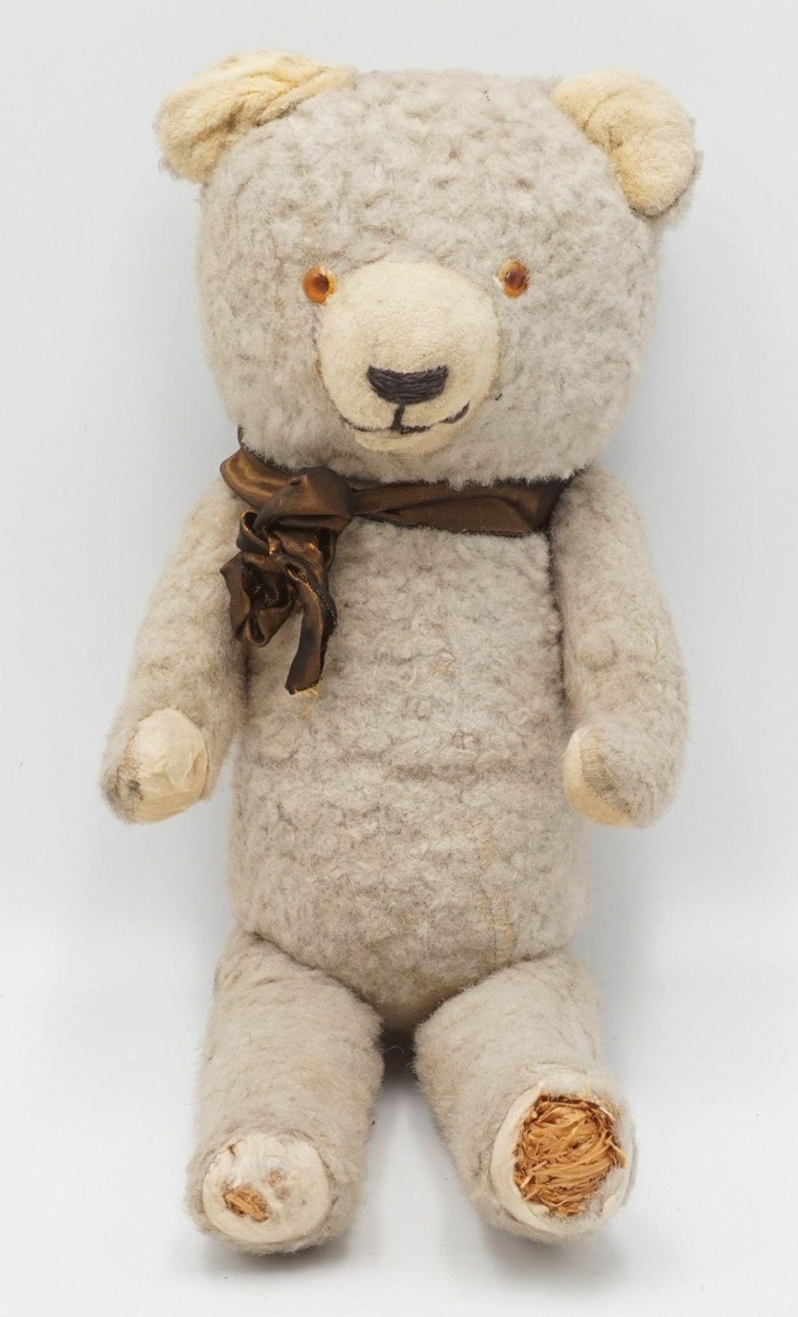 Teddybär mit Schleife, Mitte 20. Jh.