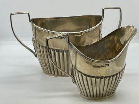 Silver milk jug and sugar basin