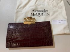 Alexander McQueen skull four ring flat pouch. Black embossed croc calf leather four ring flat