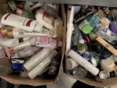 Two boxes part used toiletries and cosmetics.