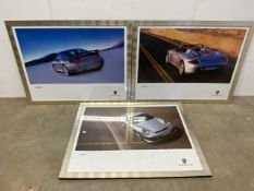 Three framed large scale Porsche posters Carrera GT and 911 Turbo etc.