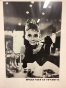 Two framed prints. Audrey Hepburn as Holly Golightly in Breakfast at Tiffany's and the knock out