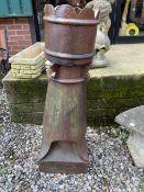 A large glazed chimney pot.W:40cm x D:40cm x H:119cm