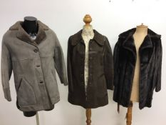 A 1970s sheepskin coat, a 1970s faux fur jacket and a 1960s suede leather trimmed coat.