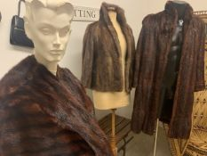 A 1950s musquash fur coat together with a 1950s mink fur jacket and a 1950s mink fur cape.