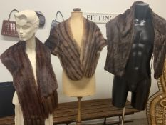 A collection of fur shawls including fox, squirrel and mink.