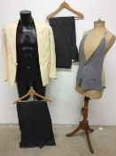 A white vintage dinner jacket and waistcoat together with two pairs of morning trousers.