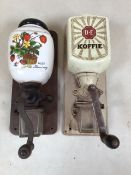Two wall mounted ceramic and glass coffee grinders. Douwe Egberts and wild strawberry.