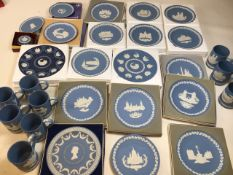 A large collection of Wedgwood commemorative Christmas Jasper ware plates and tankards together with