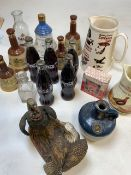 A collection empty Bells Old Scotch Whisky decanters with glass Bells decanter.